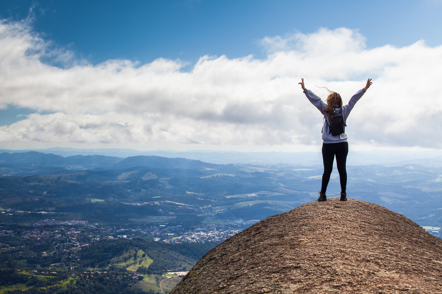 Happiness - Girl on the top of a rock / mountain